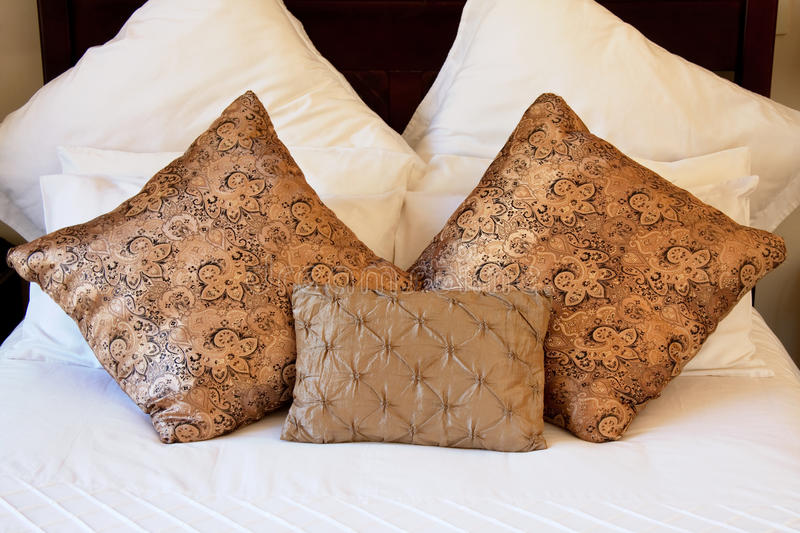 Download Gold pillows on white bed stock photo. Image of pillow - 17833342