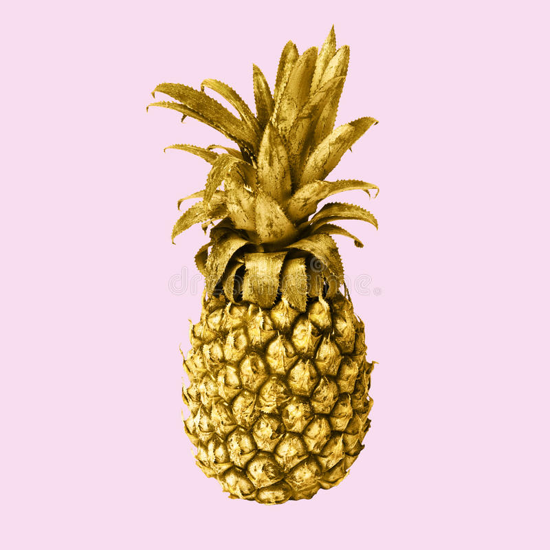 It is the gold pineapple isolated on pink background stock images