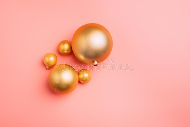 Gold and pink Christmas balls on wite background. Flat lay, top view copy space. Gold and pink Christmas balls on wite background. Flat lay, top view stock photography
