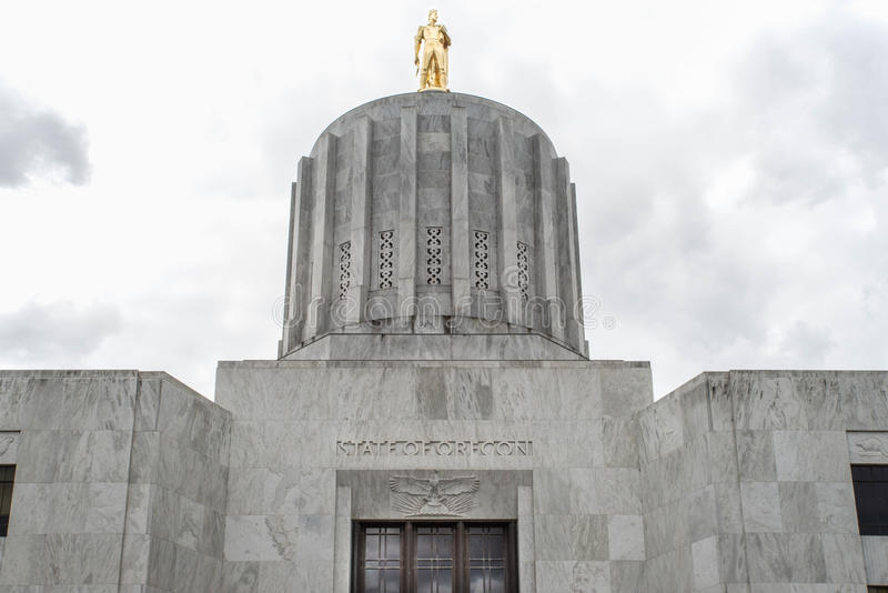 Gold pioneer atop the Oregon State Capitol. Dome and golden pioneer statue on the dome of the Oregon State Capitol Building in Salem royalty free stock photography