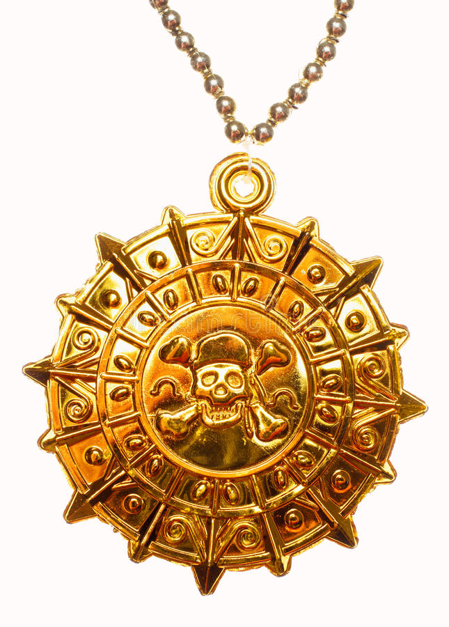 Gold pirate medallion. Gold medallion with skull and crossed bones isolated royalty free stock image