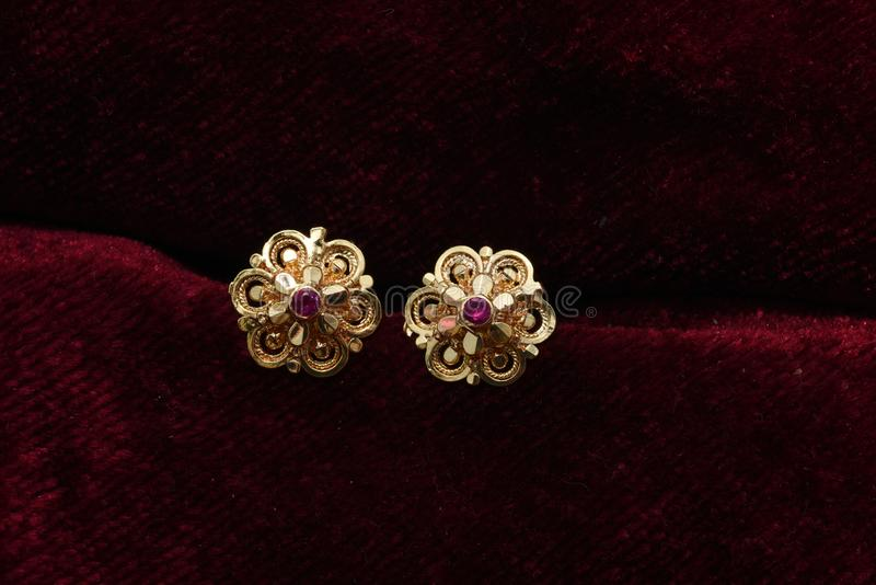 Gold plated jewelry -Fancy Designer golden earrings macro image stock images