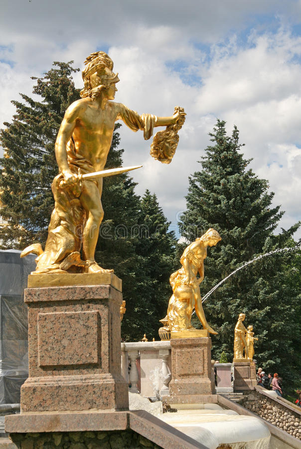 Gold plated sculptures by fountains Grand cascade in Pertergof, Saint-Petersburg, Russia stock photos