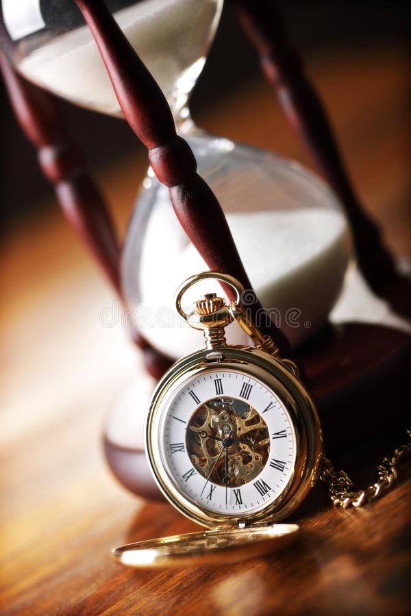 Download Gold Pocket Watch And Hourglass Stock Photo - Image of timer, chain: 17703034