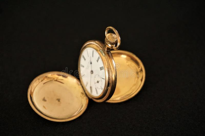 Gold pocketwatch double hunter case royalty free stock photo