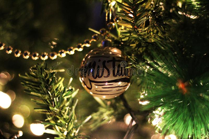 Gold Printed Bauble On Christmas Tree royalty free stock photo