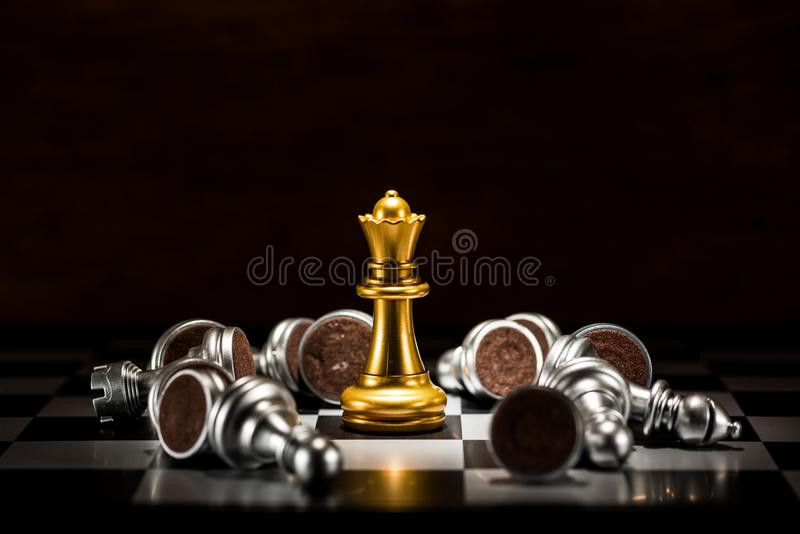 Gold queen chess surrounded by a number of fallen silver chess p. Ieces , business strategy concept