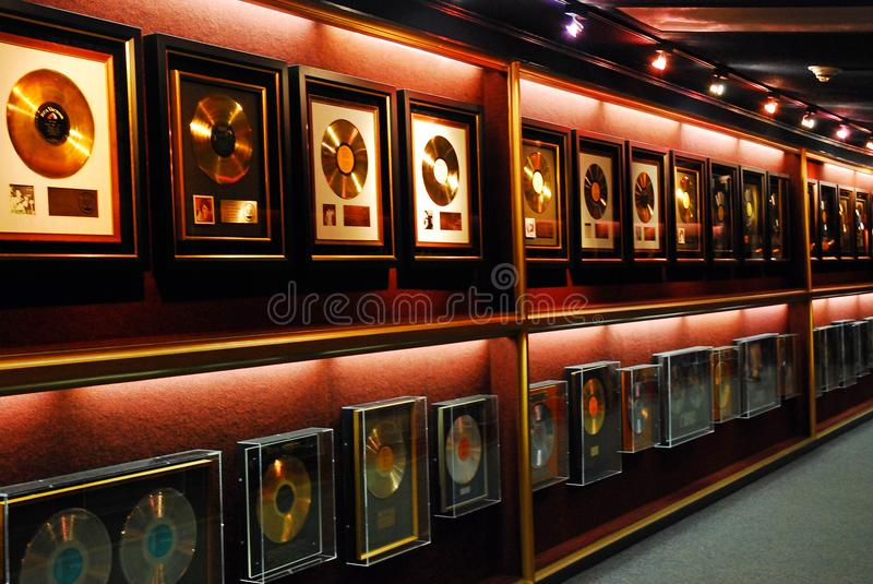 Gold records on the Wall. Gold Records Hang on the Wall at Elvis Presley`s Graceland in Memphis, Tennessee royalty free stock image