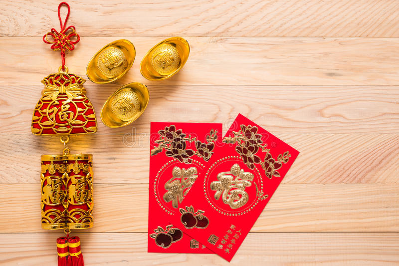 Gold and red Chinese new year decoration on wooden background stock images