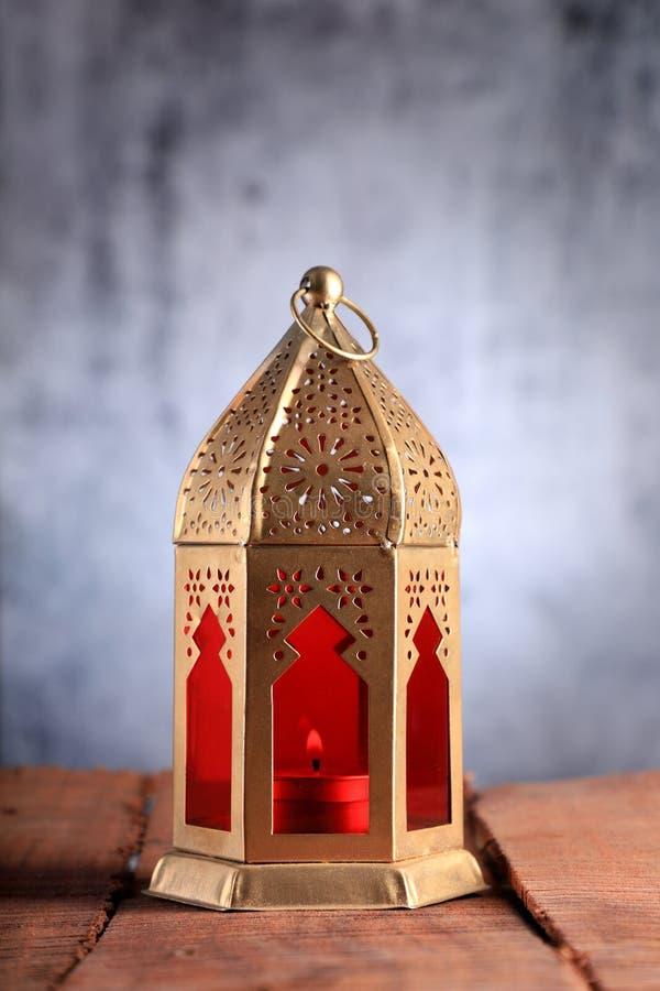 Gold and Red Islamic Lantern for Ramadan / Eid Celebrations. On grey background stock photo