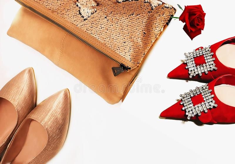 Gold red shoes handbag women accessories luxury stylish fashion trends clothes copy space  background isolate. Gold and red shoes handbag women accessories stock images