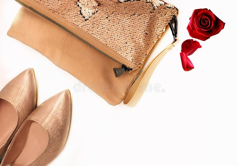 Gold red shoes handbag women accessories luxury stylish fashion trends clothes copy space  background isolate. Gold and red shoes handbag women accessories royalty free stock photo