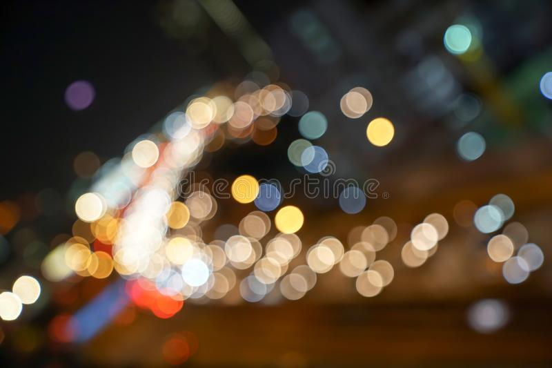 Gold, red, white, gray etc., blurry bokeh light in the expressway view Bangkok cityscape for background royalty free stock photos