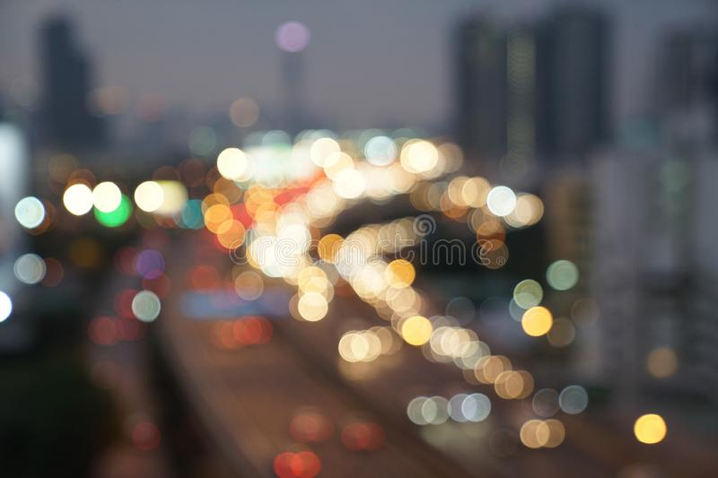 Gold, red, white, gray etc., blurry bokeh light in the expressway view Bangkok cityscape for background stock photos