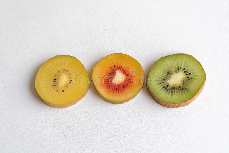 Gold, red and yellow kiwi fruit sliced royalty free stock images