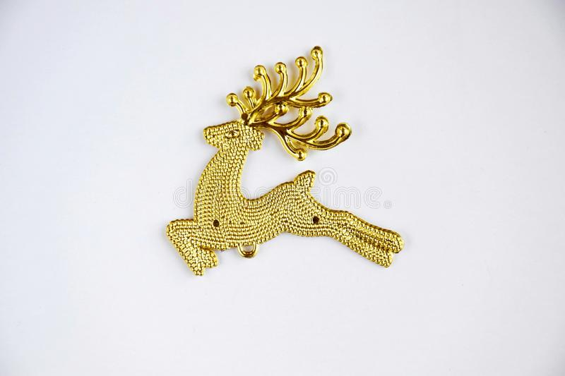 Gold Reindeer. On white background royalty free stock images