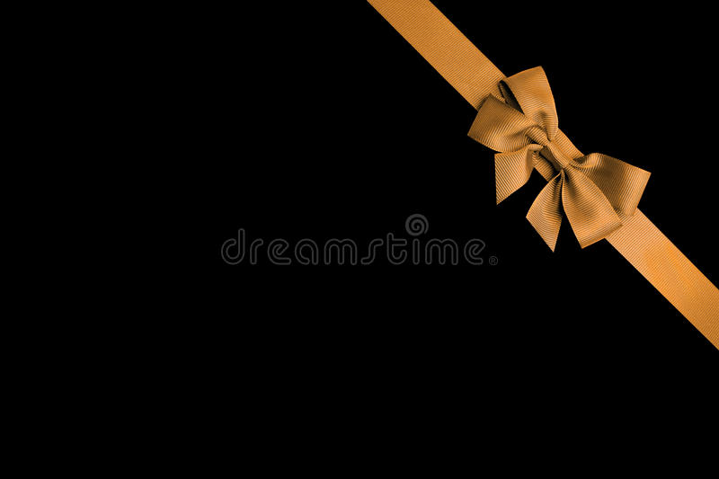 Gold ribbon with background. Gold ribbon isolated on back background stock photos