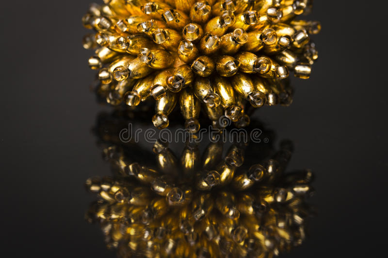 Gold ring of beads stock photos