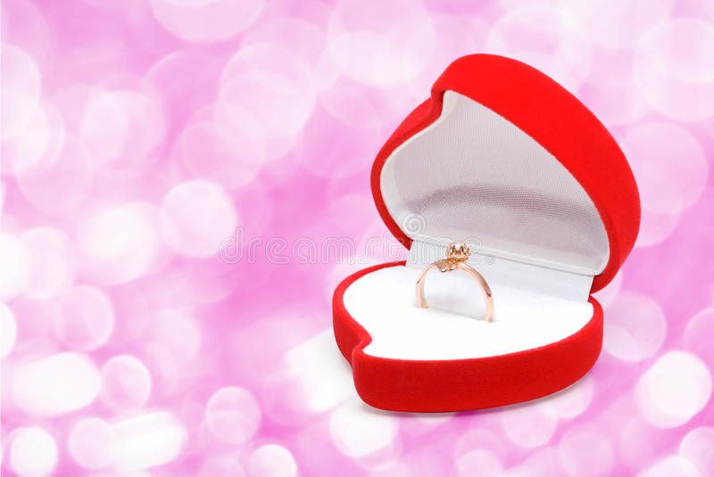 Gold ring in box stock photo