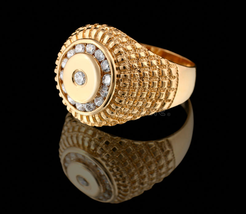 Gold ring with brilliants on black stock photos