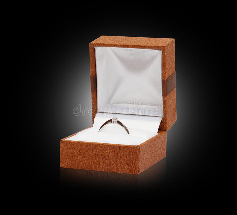 Gold ring with diamond in box royalty free stock image