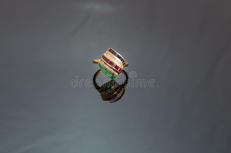 Diamond and colorful gems gold ring royalty free stock photography