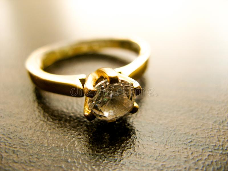 Gold ring  diamond gem closeup. Gold wedding or engagement  ring decorated with diamond royalty free stock photography