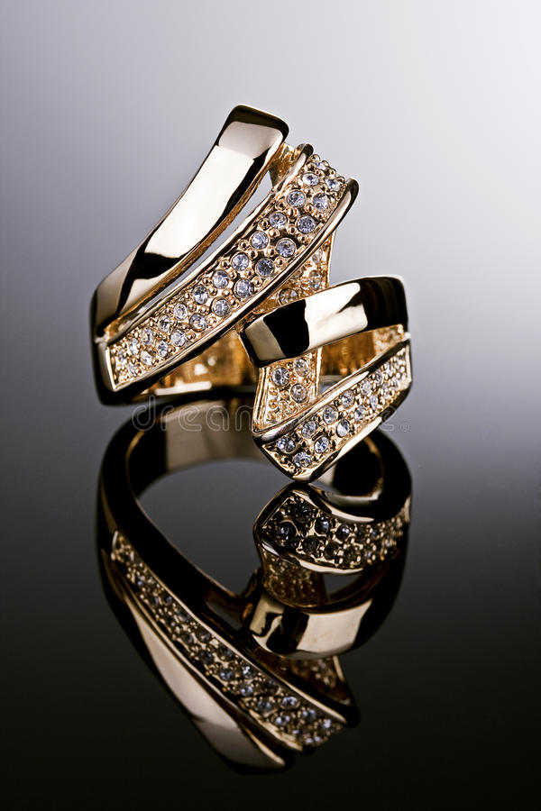 Gold ring with diamonds. royalty free stock photography