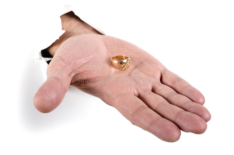 Gold ring on the hand royalty free stock images
