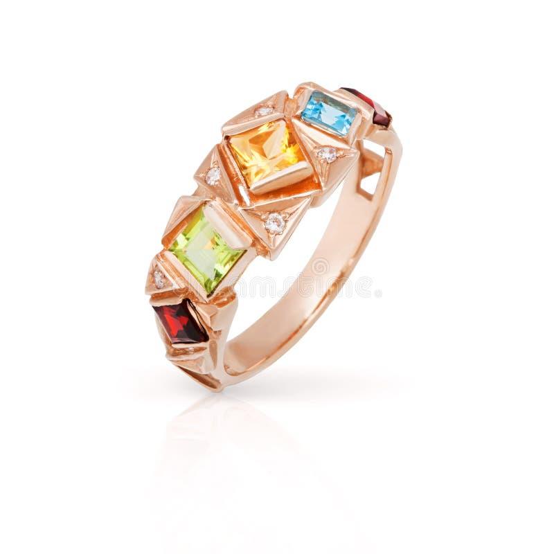 Gold ring with precious stones stock photos