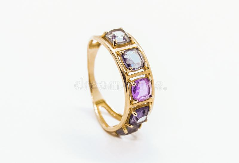 Gold ring with precious stones royalty free stock images