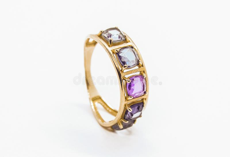 Gold ring with precious stones stock image