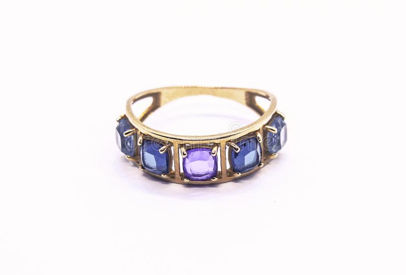 Gold ring with precious stones royalty free stock photography