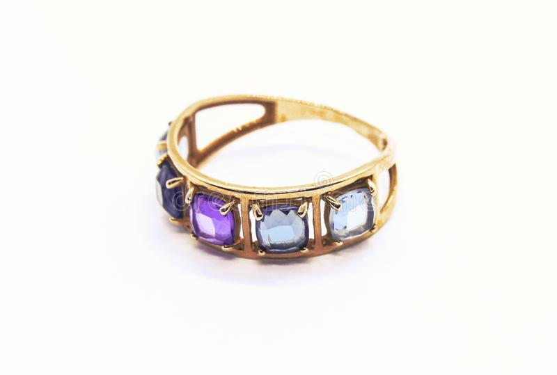 Gold ring with precious stones stock images