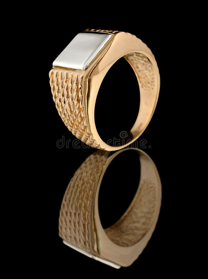 Gold ring with reflection on black stock photo