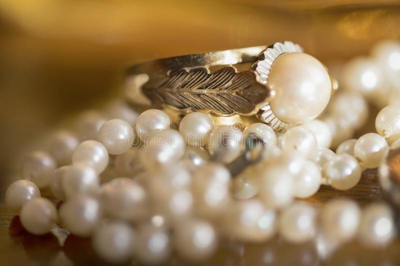 Gold ring with set pearl stock photography