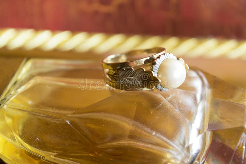 Gold ring with set pearl royalty free stock photo