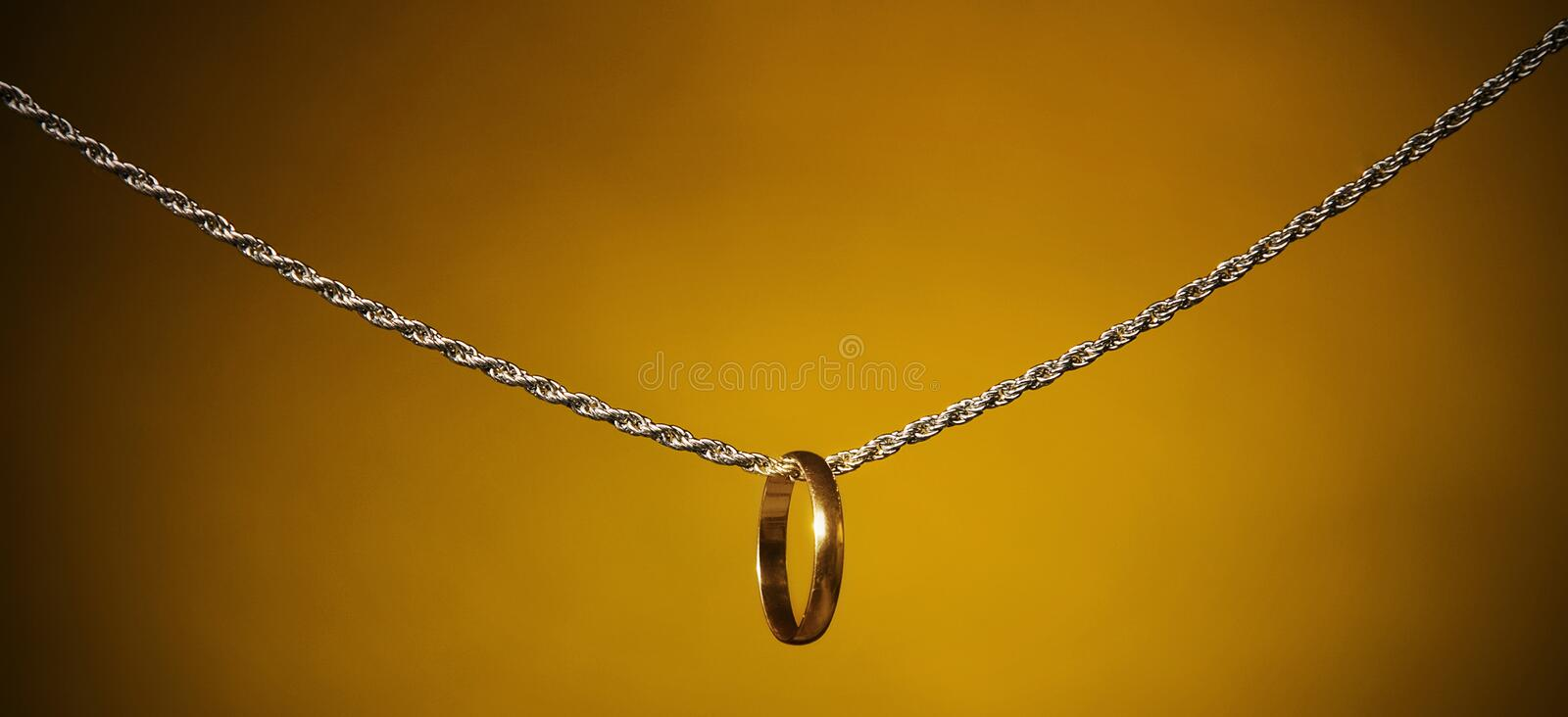 Download Gold  Ring On A Silver Chain; Stock Image - Image: 18243407