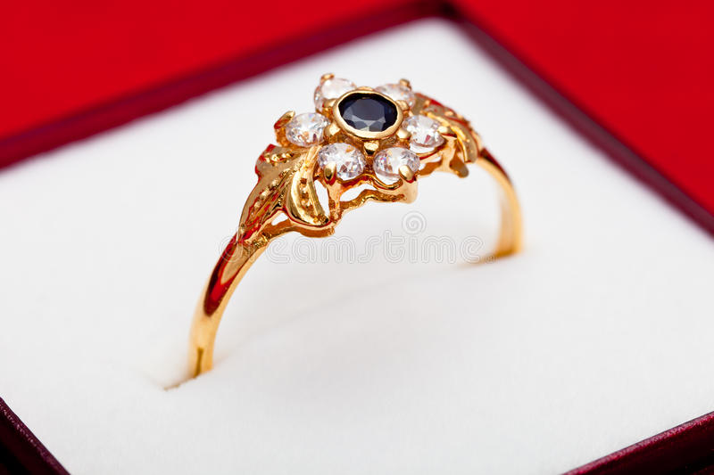 Gold ring with white and blue zirconia enchased royalty free stock photo