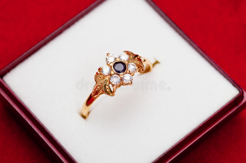 Gold ring with white and blue zirconia enchased stock photos