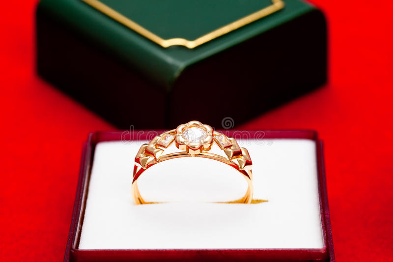 Gold ring with white zirconia enchased stock photography
