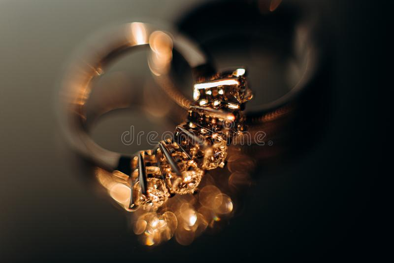 gold rings jewelry precious  macro glitter reflection stock image