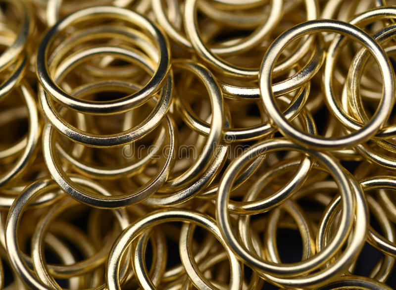 Gold Rings. A jumble of gold coloured rings royalty free stock photography