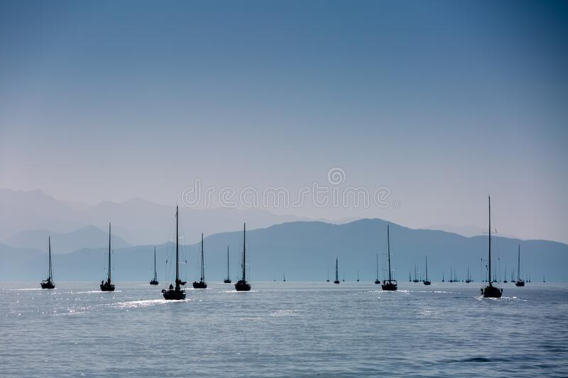 Yacht silhouette in the high sea on sunset royalty free stock images