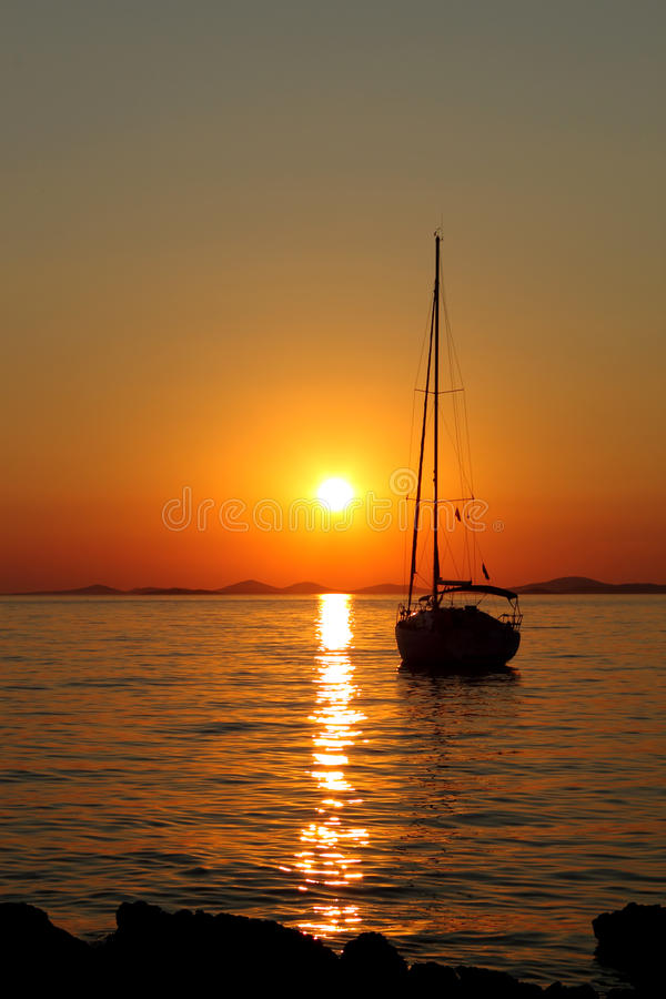 Gold romantic sunset with yacht royalty free stock photos