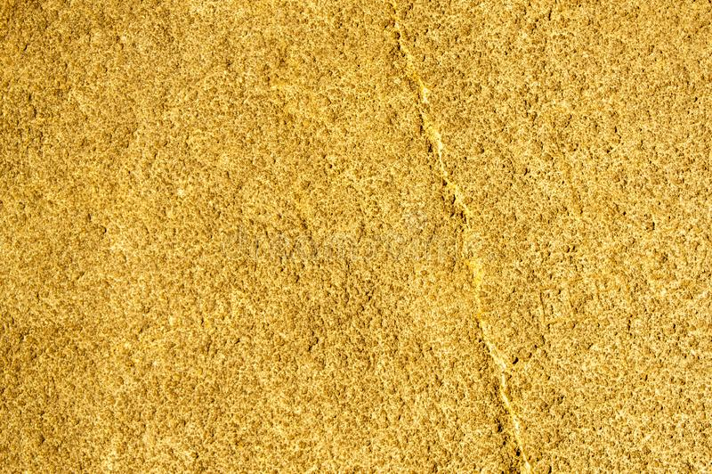 Gold rough vintage stone texture closeup background. Copy space background stock photography