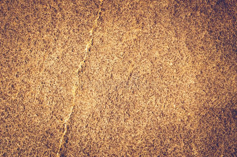 Gold rough vintage stone texture closeup background. Copy space background stock images