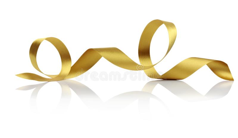 Gold Satin Ribbon Twirl. Isolated curl of gold satin ribbon on white reflective background royalty free stock photography