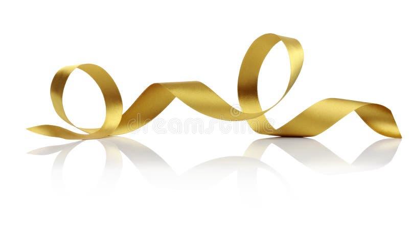 Gold Satin Ribbon Twirl royaltyfri fotografi