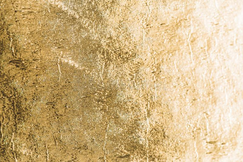 Gold shiny foil background, yellow gloss metallic texture stock images